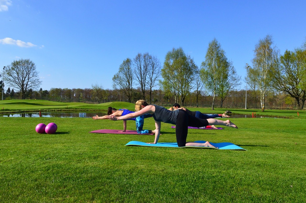 Women doing Pilates in the park